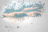 Splash on wall revealing blue sky