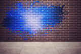 Splash on wall revealing blue light