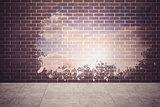 Splash on wall revealing bright sky