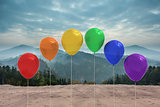 Balloons in front of mountains