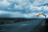 Balloons above a road