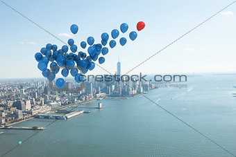 Many colourful balloons above coast