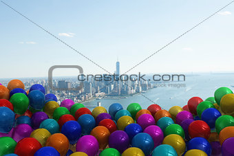 Many colourful balloons against coast