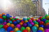 Many colourful balloons in the street