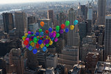 Many colourful balloons above city