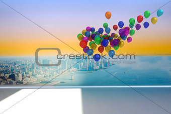Many colourful balloons in room with city scene