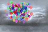 Many colourful balloons in cloudy room