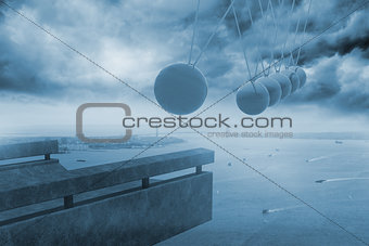 Newtons cradle above coastline