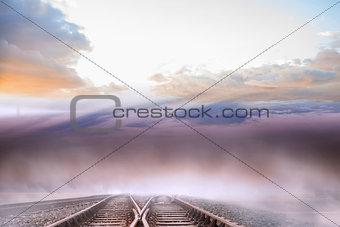 Train tracks leading to misty horizon