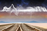 Train tracks under energy wave in desert