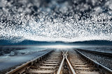 Train tracks under blanket of bright stars