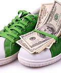 Paper Currency on a green shoes