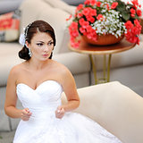 Happy bride sitting in restaurant.