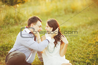 Caucasian young couple having date, spending great time in garden on summer sunny day.