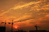 industrial construction crane against sunset in Dubai city