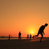 Football at Jumeira beach in Dubai during sunset.