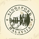 Grunge rubber stamp with Singapore, Malaysia