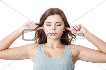 young female putting fingers in ears