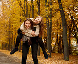 piggyback ride in autumn forest