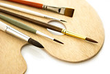 Art color brushes on woode palette isolated