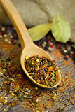 Natural spices in wooden spoon