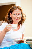 girl with a cup of coffee smiling