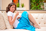 charming girl with coffee on the couch