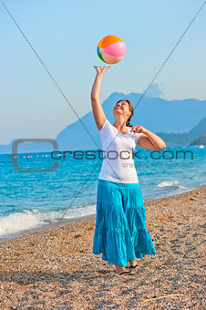 beautiful girl playing on the beach ball