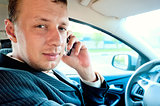 Portrait of a man driving a car with the phone