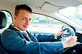 Portrait of a businessman driving a car