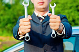 spanners in the hands of a businessman
