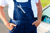 wrench sticking out of the pocket mechanic overalls