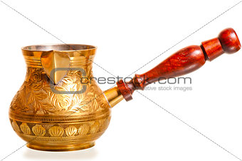 brass coffee pot with wooden handle on a white background