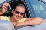 woman showing the key of her new car
