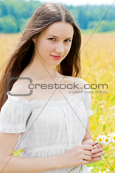 portrait of Russian beauties in a field with flowers