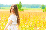 woman with long hair in field