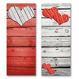 Paper hearts on a wooden surface