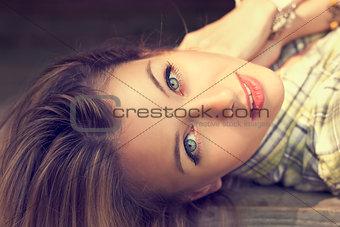 Portrait of Lying Beautiful Woman