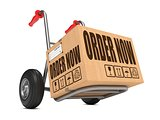 Order Now - Cardboard Box on Hand Truck.