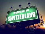 Billboard Welcome to Switzerland at Sunrise.