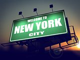 Billboard Welcome to New York at Sunrise.