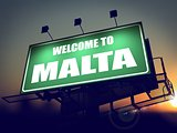 Billboard Welcome to Malta at Sunrise.
