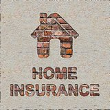 Home Insurance Concept on the Brick Wall.