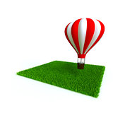 bright baloon and lawn from a green bright grass on a white background