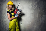 Builder woman with a drill