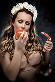Woman with red apple and snake