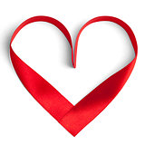 Red ribbon in a heart shape isolated on white.