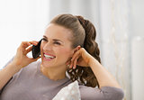 Happy young woman talking mobile phone