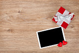 Blank photo frame and small red gift box