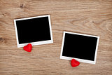 Two photo frames and small red candy hearts